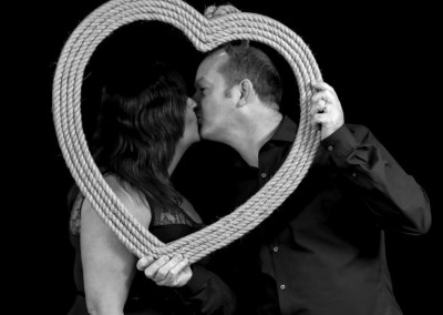 Photobooth kiss in a heart frame